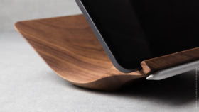 05 yohann product YP1WA ipad pro stand with apple pencil holder large size walnut wood close up angled side view with ipad pro and apple pencil in magnetic holder