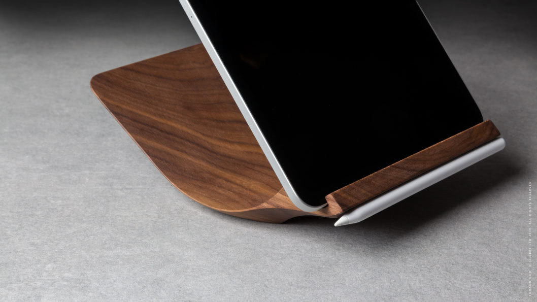13 yohann product YP1WA ipad pro stand with apple pencil holder large size walnut wood angled side view with ipad pro and apple pencil in magnetic holder